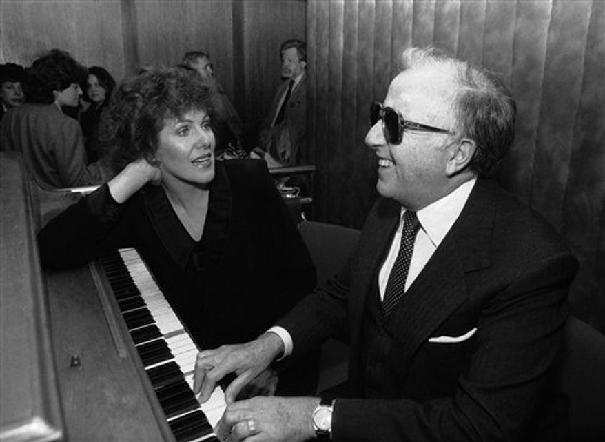 "FILE - In this This 1972 file photo, jazz pianist George Shearingis shown.  Shearing, the ebullient jazz pianist who wrote the standard ""Lullaby of Birdland"" and had a string of hits both with and without his quintet, died Monday, Feb. 14, 2011 in Manhattan of congestive heart failure.  He was 91. (AP Photo, file)"
