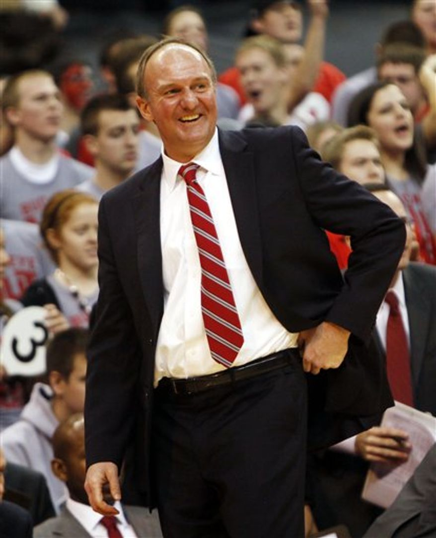 FILE - In this Jan. 15, 2011 file photo, Ohio State coach Thad Matta smiles after a play during the second half of an NCAA college basketball game against Penn State in Columbus, Ohio. With just seven regular-season games left, top-ranked Ohio State is flirting with history as it tries to become the first Division I team since Indiana in 1975-76 to go unbeaten. There are plenty of tests ahead _ starting with Saturday's game at Wisconsin. (AP Photo/Terry Gilliam, File)