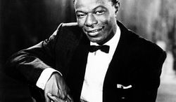 """FILE - In this undated file photo, singer and pianist Nat """"King"""" Cole is shown. More than 50 years after its initial airing on television, the estate of Nat King Cole plans to digitally release The Nat King Cole Show on iTunes. (AP Photo, file)"""