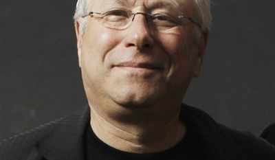 FILE - In this Feb. 7, 2011 file photo, songwriter Alan Menken, poses for a portrait before the Academy Award Nominees Luncheon in Beverly Hills, Calif. (AP Photo/Matt Sayles, file)
