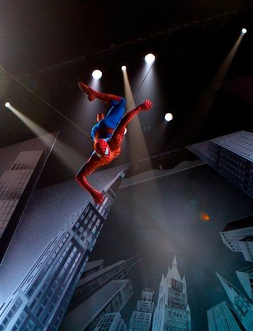 """In this theater publicity image released by The O and M Co., Reeve Carney, center, portrays Peter Parker in a scene from the musical """"Spider-Man: Turn Off the Dark,"""" in New York. (AP Photo/The O and M Co., Jacob Cohl)"""