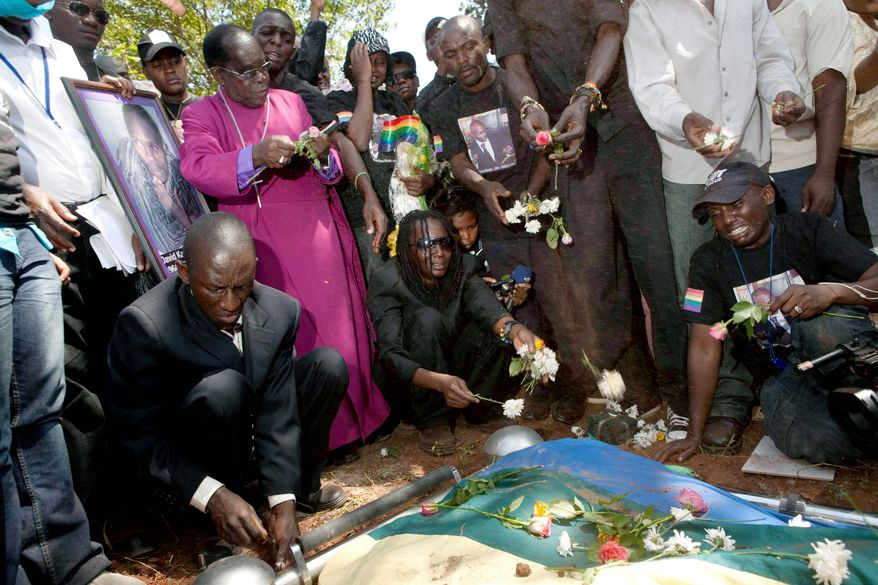 Mourners pay their last respects during the funeral of David Kato, a Ugandan gay-rights activist, in Mukono, Uganda, last month. Activists were outraged over the death of Kato, an advocacy officer for the gay-rights group Sexual Minorities Uganda. His slaying comes after a year of stepped-up threats against gays in Uganda, where a controversial bill has proposed the death penalty for some homosexual acts. (Associated Press)