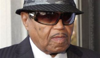 """FILE - In this June 14, 2010 file photo Joe Jackson, the father of  the late pop star Michael Jackson, arrives to a Los Angeles courthouse for a preliminary hearing setting and motions in the trial of Jackson's personal doctor Conrad Murray. Joe Jackson was in Vietnam to attend groundbreaking ceremony for a five-star hotel and amusement park called """"Happyland"""" on Monday, Feb. 14, 2011. (AP Photo/Nick Ut, File)"""