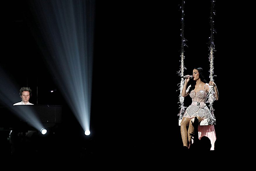 Katy Perry, right, performs at the 53rd annual Grammy Awards on Sunday, Feb. 13, 2011, in Los Angeles. (AP Photo/Matt Sayles)
