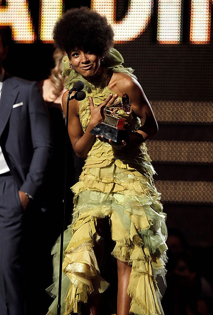 Esperanza Spalding accepts the award for best new artist at the 53rd annual Grammy Awards on Sunday, Feb. 13, 2011, in Los Angeles. (AP Photo/Matt Sayles)