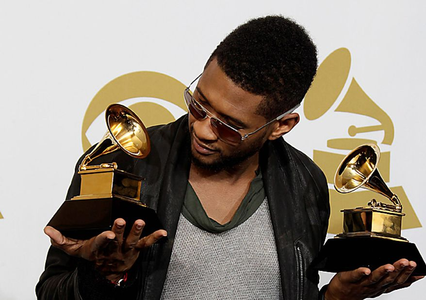 ** FILE ** Usher poses backstage with his awards for best male R&B vocal and best contemporary R&B album at the 53rd annual Grammy Awards on Sunday, Feb. 13, 2011, in Los Angeles. (AP Photo/Jae C. Hong)