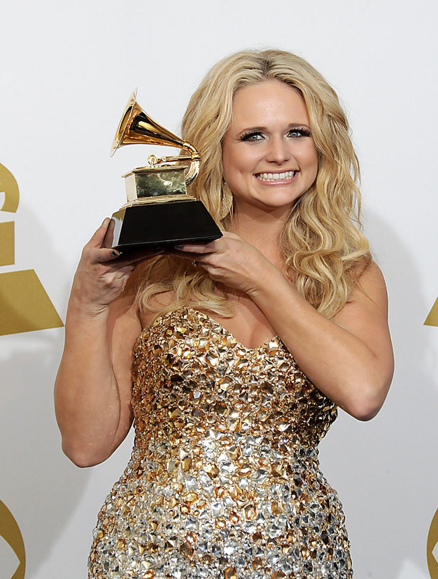 Miranda Lambert poses backstage with the award for best female country vocal performance at the 53rd annual Grammy Awards on Sunday, Feb. 13, 2011, in Los Angeles. (AP Photo/Jae C. Hong)