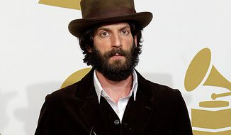 Ray LaMontagne poses backstage with the award for best contemporary folk album at the 53rd annual Grammy Awards on Sunday, Feb. 13, 2011, in Los Angeles. (AP Photo/Jae C. Hong)