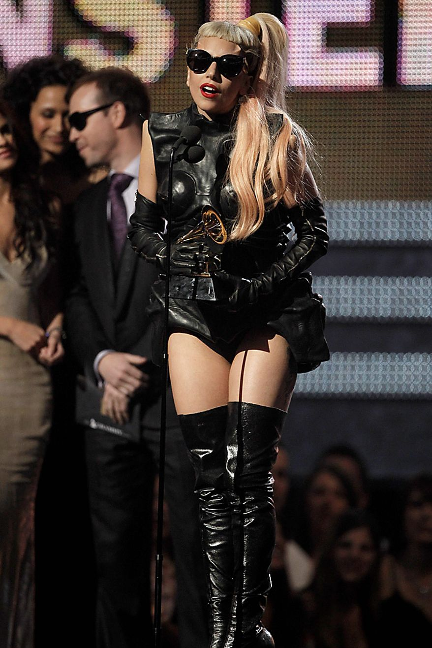 Lady Gaga accepts the award for best pop vocal album onstage at the 53rd annual Grammy Awards on Sunday, Feb. 13, 2011, in Los Angeles. (AP Photo/Matt Sayles)