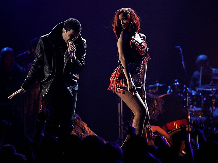 Drake, left, and Rihanna perform at the 53rd annual Grammy Awards on Sunday, Feb. 13, 2011, in Los Angeles. (AP Photo/Matt Sayles)