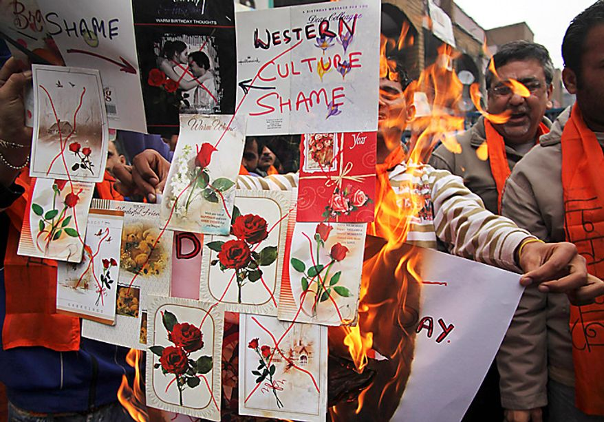 Hindu nationalist Shiv Sena activists burn greeting cards during a protest against Valentine's Day celebrations in Jammu, India, on Monday, Feb. 14, 2011. Hard-line Hindu groups routinely protest against the perceived invasion of Western culture into India. (AP Photo/Channi Anand)