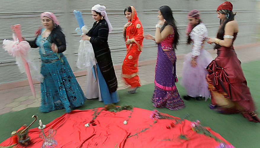 Queen witch Mihaela Minca (left), followed by apprentices Ana, Melisa, Esmeralda, Casanndra and Alice, performs a Valentine's Day ritual in Mogosoaia, Romania, on Monday, Feb. 14, 2011. The witches' ceremony is crafted to help people find true love. (AP Photo/Vadim Ghirda)