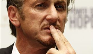 U.S. actor Sean Penn attends a news conference about the Haiti fund raising gala in Vienna, Austria, on Tuesday Feb. 15, 2011. (AP Photo/Ronald Zak)