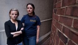 **FILE** Veterans Kori Cioca (left), 25, of Wilmington, Ohio, and Panayiota Bertzikis, 29, of Somerville, Mass., who were assaulted and raped while serving in the U.S. Coast Guard, meet at their attorney's office in Washington on Feb. 13, 2011. They are plaintiffs among about a dozen women and at least one man, who are suing Pentagon officials, seeking change in the military's handling of rape and sexual assault cases. (Associated Press)