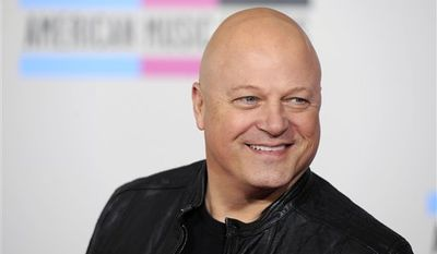 FILE - In this Nov. 21, 2010 file photo, Michael Chiklis arrives at the 38th Annual American Music Awards in Los Angeles. (AP Photo/Chris Pizzello, file)