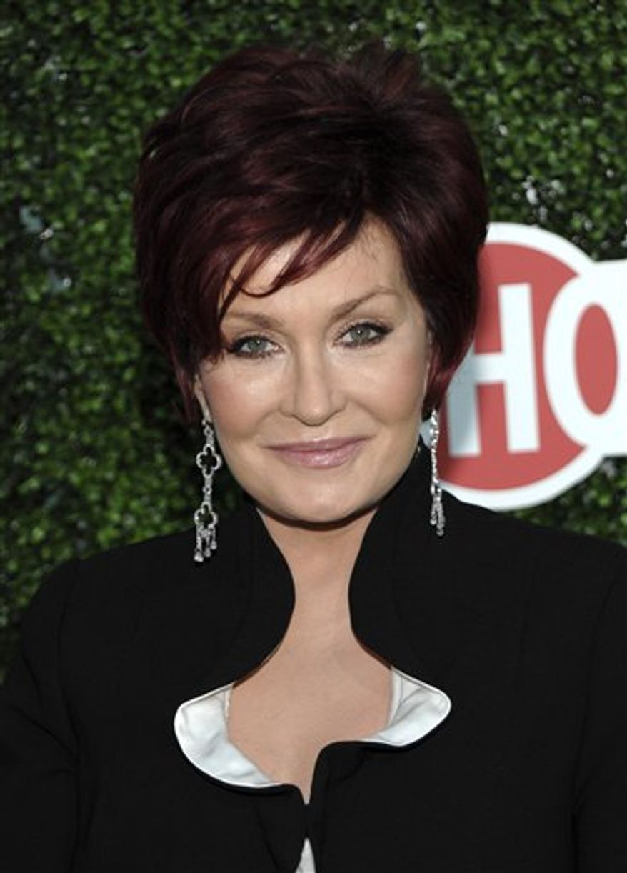 """FILE - In this July 28, 2010 file photo, Sharon Osbourne arrives at the CBS CW Showtime press tour party in Beverly Hills, Calif. Osbourne and a former contestant on her VH1 show """"Rock of Love Charm School"""" have settled a battery and negligence lawsuit on the eve of trial. The case was about to begin on Monday, Feb. 14, 2011. (AP Photo/Dan Steinberg, file)"""
