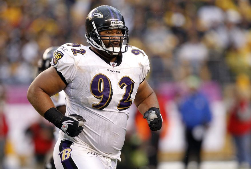 FILE - In this Oct. 3, 2010 file photo, Baltimore Ravens defensive tackle Haloti Ngata (92) heads to the sidelines during an NFL football game against the Pittsburgh Steelers in Pittsburgh. The Ravens have designated Ngata as their franchise player on Tuesday, Feb. 15, 2011. (AP Photo/Keith Srakocic, File)