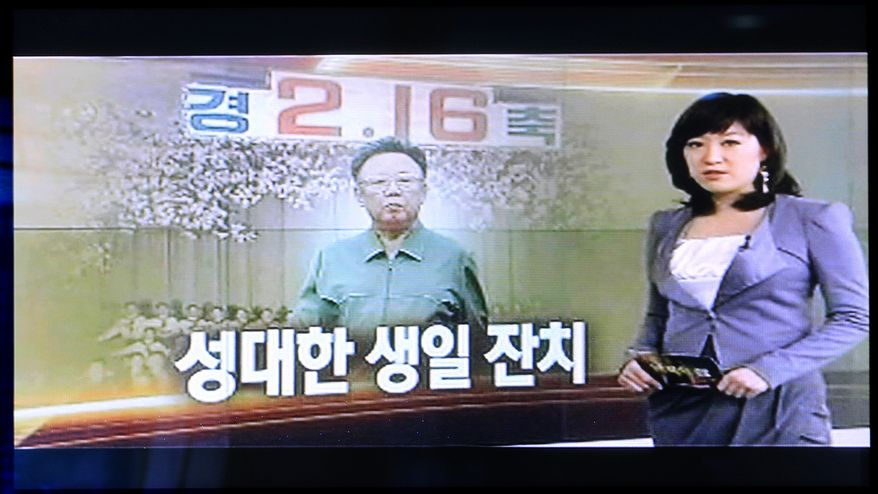 "A South Korean television station airs a program about North Korean leader Kim Jong-il's birthday, seen on a TV screen at the North Korea exhibition hall of the unification observation post in Paju, South Korea, near the border village of Panmunjom, on Tuesday, Feb. 15, 2011. North Koreans will celebrate their leader's 69th birthday Wednesday, one of the country's most important holidays. The screen reads ""Magnificent, Birthday Party"" in the Korean language. (AP Photo/Lee Jin-man)"