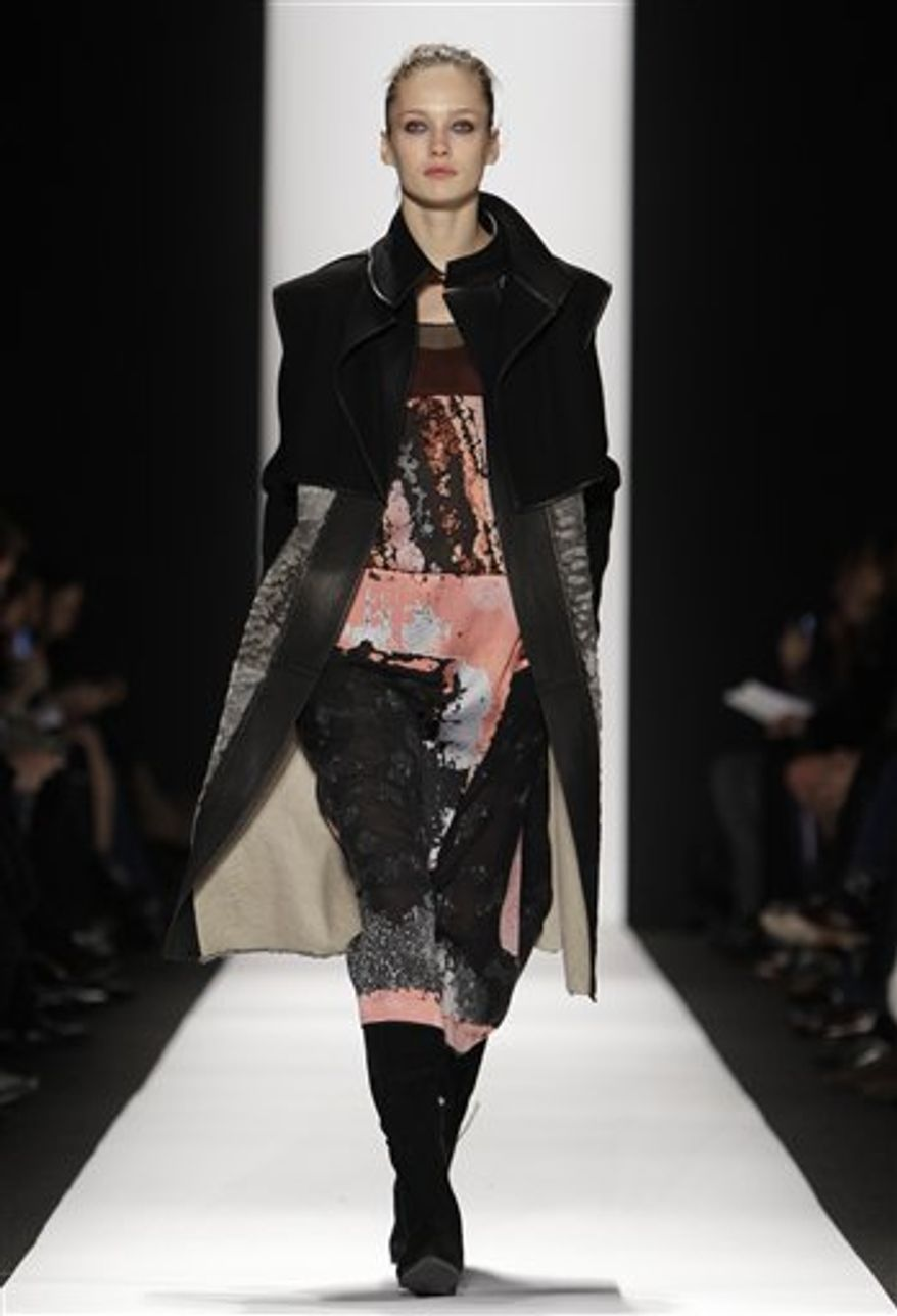 A model walks the runway at the Narciso Rodriguez Fall 2011 show at Lincoln Center during Fashion Week in New York, Tuesday, Feb. 15, 2011. (AP Photo/Kathy Willens)