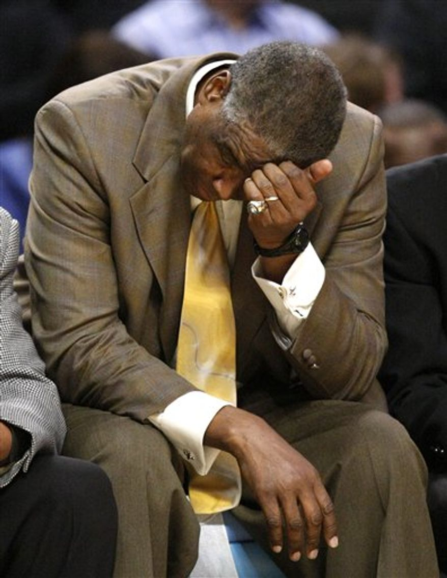 Charlotte Bobcats coach Paul Silas scratches his head on the bench during the second half of an NBA basketball game against the Chicago Bulls on Tuesday, Feb. 15, 2011, in Chicago. The Bulls won 106-94. (AP Photo/Charles Rex Arbogast)