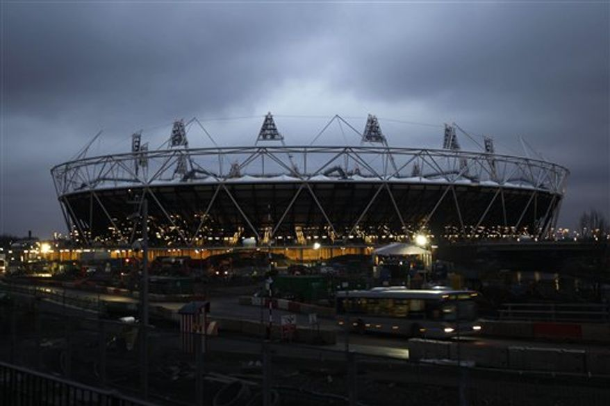 The main stadium for the 2012 London Olympics is seen illuminated as the daylight fades in Stratford, London, Friday, Feb. 11, 2011.  West Ham was selected Friday to take over the Olympic Stadium after the 2012 London Games, beating out Premier League rival Tottenham and fulfilling Britain's promise to retain a running track at the showpiece venue.  (AP Photo/Matt Dunham)