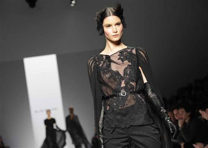 The Elie Tahari Fall 2011 collection is modeled during Fashion Week, Wednesday, Feb. 16, 2011, in New York. (AP Photo/Louis Lanzano)