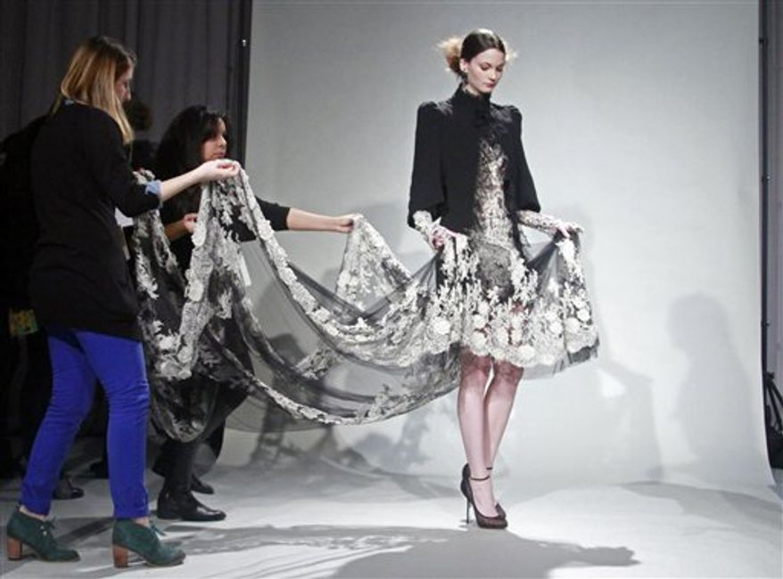 Fashion from the fall 2011 Marchesa collection is modeled on Wednesday, Feb. 16, 2011 in New York.  (AP Photo/Bebeto Matthews)