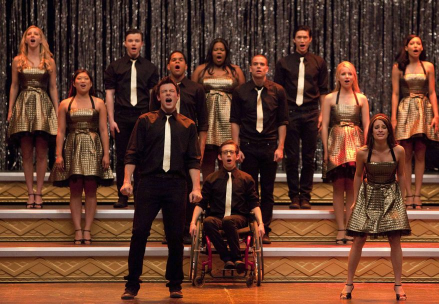 "In this 2010 publicity image released by Fox, the cast of ""Glee,"" front row from left, Cory Monteith, Kevin McHale and Lea Michele, center row from left, Jenna Ushkowitz, Dijon Talton, Mark Salling and Dianna Agron, back row from left, Heather Morris, Chris Colfer, Amber Riley, Harry Shum Jr. and Naya Rivera perform ""Don't Stop Believing"" in the season finale episode of the series which aired on June 8, 2010. (AP Photo/Fox, Adam Rose)"