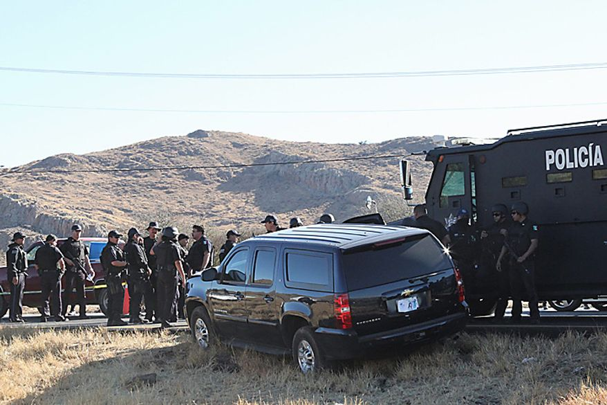 ** FILE ** Mexican federal police guard a U.S. Embassy vehicle after it came under fire from unknown gunmen on Highway 57 between Mexico City and Monterrey, near the town of Santa Maria Del Rio in San Luis Potosi state, Mexico, on Tuesday, Feb. 15, 2011. A U.S. Immigration and Customs Enforcement agent was killed, and another was wounded in the attack. (AP Photo/Pulso Diario de San Luis, Teodoro Blanco Vazquez)