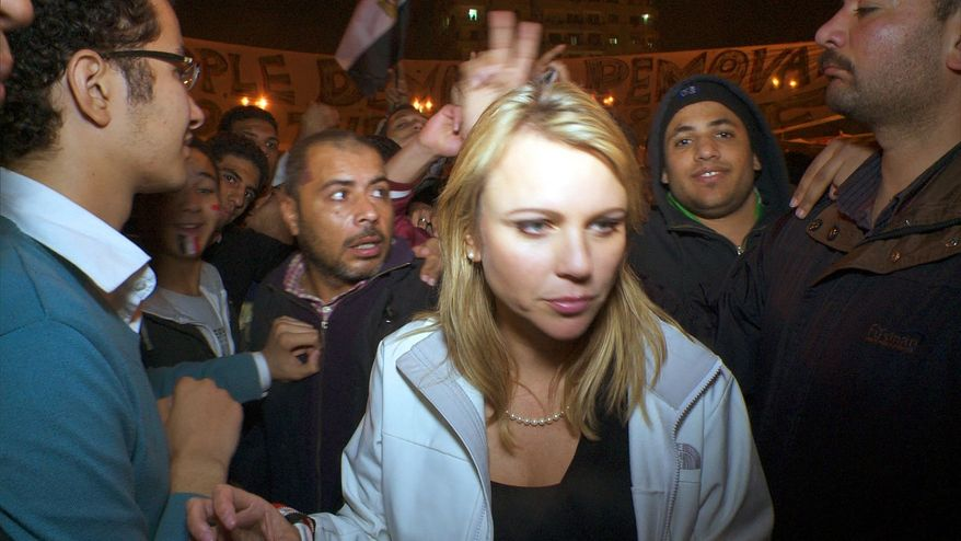 """In this Feb. 11, 2011, photo released by CBS, """"60 Minutes"""" correspondent Lara Logan is shown covering the reaction in in Cairo's Tahrir Square the day Egyptian President Hosni Mubarak stepped down. CBS News says Logan was attacked Friday, and suffered a brutal beating and sexual assault before being saved by a group of women and an estimated 20 Egyptian soldiers. She is recovering in a U.S. hospital. (AP Photo/CBS News)"""