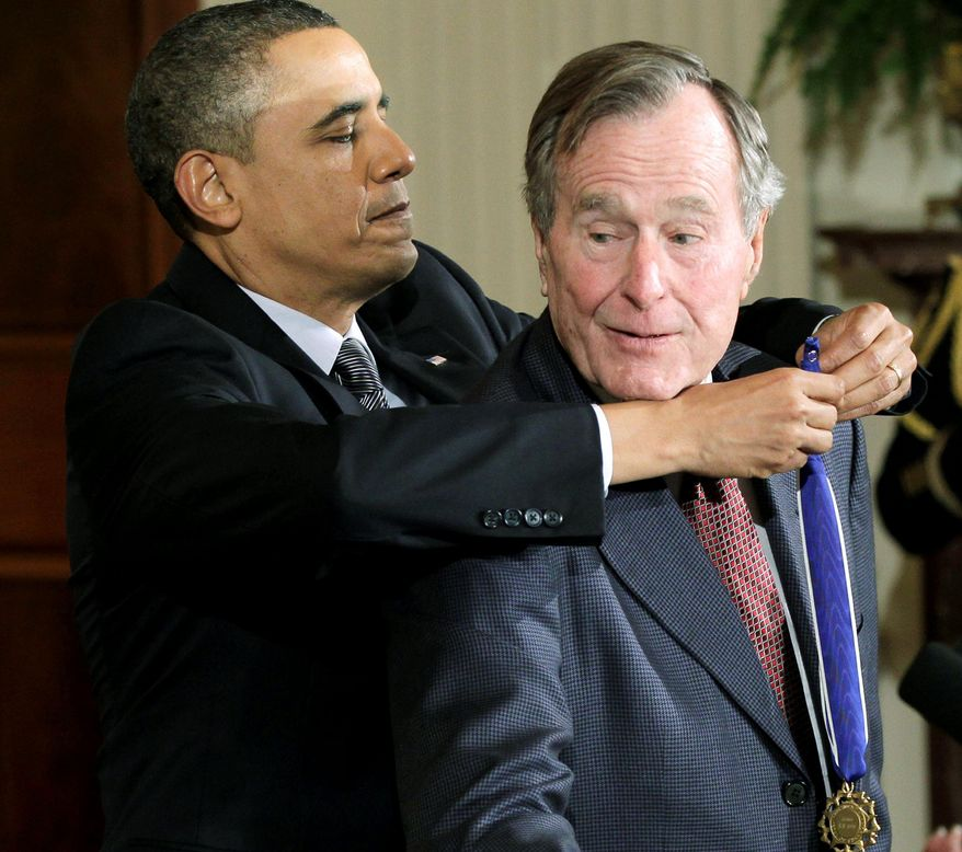 "President Obama presents the Medal of Freedom, the nation's highest civilian honor, to former President George H.W. Bush Tuesday at the White House. Mr. Obama said Mr. Bush's ""humility and his decency reflects the very best of the American spirit."" (Associated Press)"