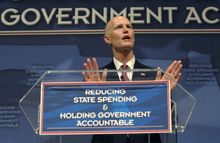 Florida Gov. Rick Scott announces his new budget during a tea party event in Eustis, Fla., on Monday, Feb. 7, 2011. (AP Photo/Phelan M. Ebenhack)