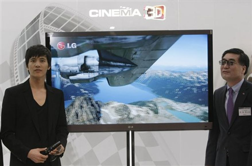Models and LG Electronics employees wearing special glasses watch a Cinema 3-D TV by LG Electronics during a press unveiling in Seoul, South Korea, Wednesday, Feb. 16, 2011. LG Electronics says competition is heating up in the global battle to win over customers to 3-D televisions and the South Korean company thinks it has gained a key edge. (AP Photo/Ahn oung-joon)