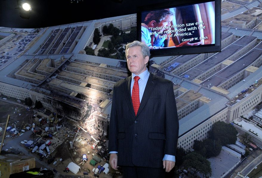 A wax figure of President George W. Bush is part of an American presidents exhibit at Madame Tussauds wax museum. The background shows scenes from the Sept. 11, 2001, terrorism attacks. (Associated Press)