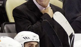 FILE - In this Sept. 28, 2010 file photo, Chicago Blackhawks coach Joel Quenneville stands behind his bench during  a preseason NHL hockey game against the Pittsburgh Penguins in Pittsburgh. The Blackhawks said Wednesday, Feb. 16, 2011, that Quenneville was in stable condition after being admitted to a Chicago area hospital with an undisclosed illness. Assistant coach Mike Haviland will fill in when the Blackhawks host Minnesota on Wednesday. (AP Photo/Gene J. Puskar, File)