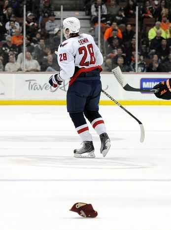 Washington Capitals left wing Alexander Semin of Russia skates off the ice as a hat falls to the ice after he scored a third goal of the night for a hat trick during the third period of their NHL hockey game against the Anaheim Ducks, Wednesday, Feb. 16, 2011, in Anaheim, Calif. The Capitals won 7-6. (AP Photo/Mark J. Terrill)