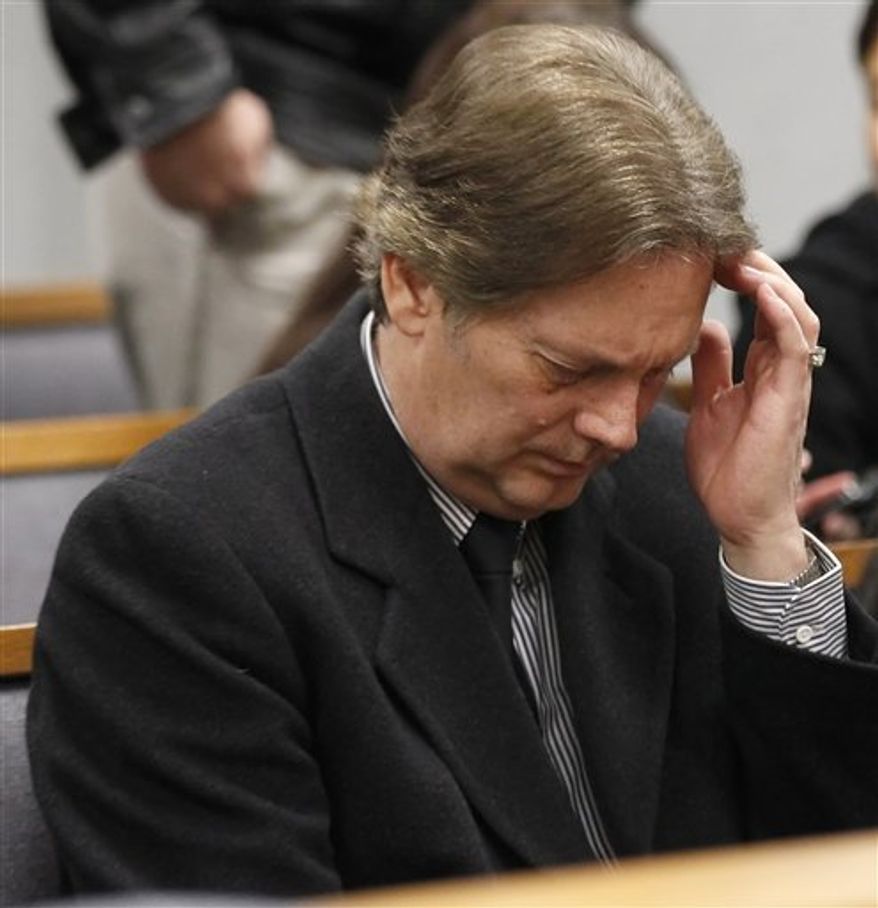 "Keith Brown, right, and his attorney Steven Shapiro talk to the judge at his hearing in Provo 4th District Court in Provo, Utah, Thursday, Feb. 17, 2011. Brown, the father of the musical group ""The 5 Browns,"" pleaded guilty to one first-degree felony count of sodomy on a child and two second-degree felony counts of sexual abuse of a child on his three daughters. Brown will be sentenced on March 31, 2011.  (AP Photo/George Frey)"