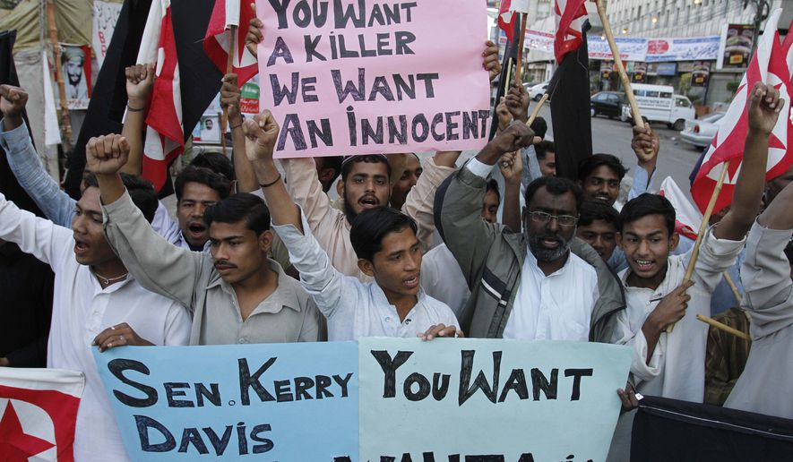 Supporters of the Pakistani religious party Jammat-e-Islami rally in Karachi, Pakistan, on Wednesday, Feb. 16, 2011, against U.S. Consulate employee Raymond Davis, who allegedly shot dead two Pakistanis whom Mr. Davis has said were trying to rob him. (AP Photo/Shakil Adil)