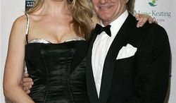 FILE - In this Nov. 30, 2007 file photo, British singer Rod Stewart, right, and his wife Penny Lancaster arrive for the Emeralds & Ivy Ball, to raise money for Cancer Research UK, at Old Billingsgate Market in London. Lancaster gave birth to the couple's second son, Aiden, born Wednesday, Feb. 16, 2011.  (AP Photo/Sang Tan, File)