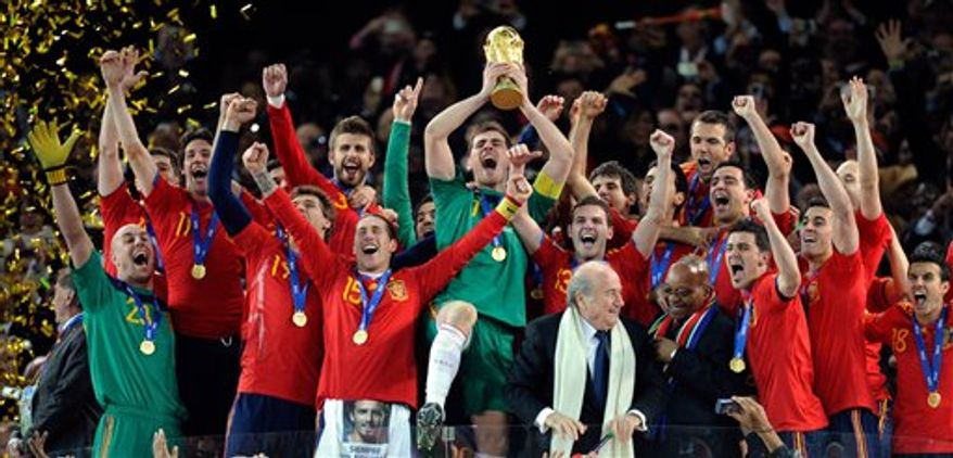 FILE - In this July 11, 2010 file photo, Spain goalkeeper Iker Casillas holds up the trophy after winning the World Cup final soccer match between the Netherlands and Spain at Soccer City in Johannesburg, South Africa. A European Union high court has ruled that countries can keep all World Cup and European Championship games on free-to-air television, arguing against FIFA and UEFA which sought the right to sell most matches to pay television. (AP Photo/Matt Dunham, File)