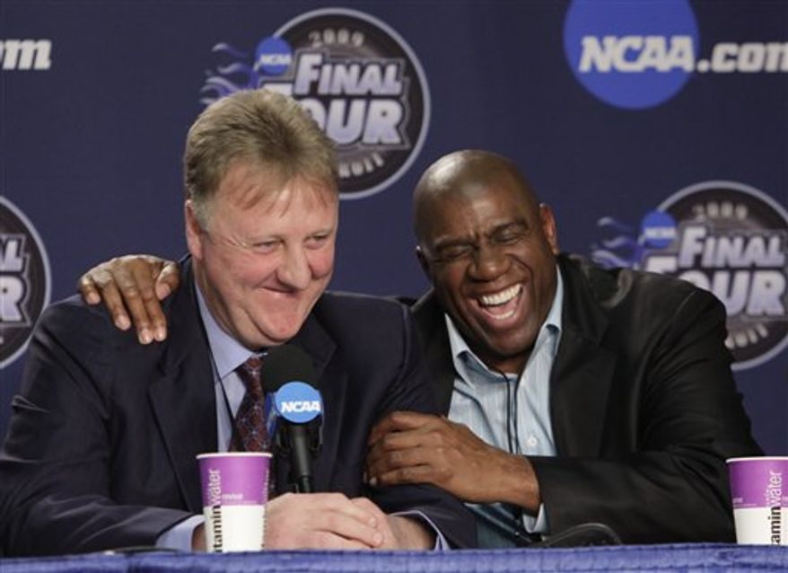 "FILE - In this April 6, 2009 file photo, former NBA players Earvin ""Magic"" Johnson, right, and Larry Bird laugh at a news conference before the championship game between Michigan State and North Carolina at the men's NCAA Final Four college basketball tournament in Detroit. The producers and playwright behind the Broadway play ""Lombardi"" are planning to go from football to basketball with ""Magic/Bird,"" a new play that will chronicle the lives of Hall of Famers Larry Bird and Earvin ""Magic"" Johnson.  (AP Photo/Paul Sancya, file)"