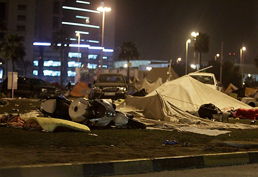 Anti-government demonstrators' damaged tents at Pearl Square in Manama, Bahrain, early Thursday morning, Feb. 17, 2011, after riot police attacked them. Riot police firing tear gas and rubber bullets stormed the landmark square occupied by anti-government protesters Thursday, driving out demonstrators and destroying a makeshift encampment that had become the hub for demands to bring sweeping political changes to the kingdom. (AP Photo/Hassan Ammar)