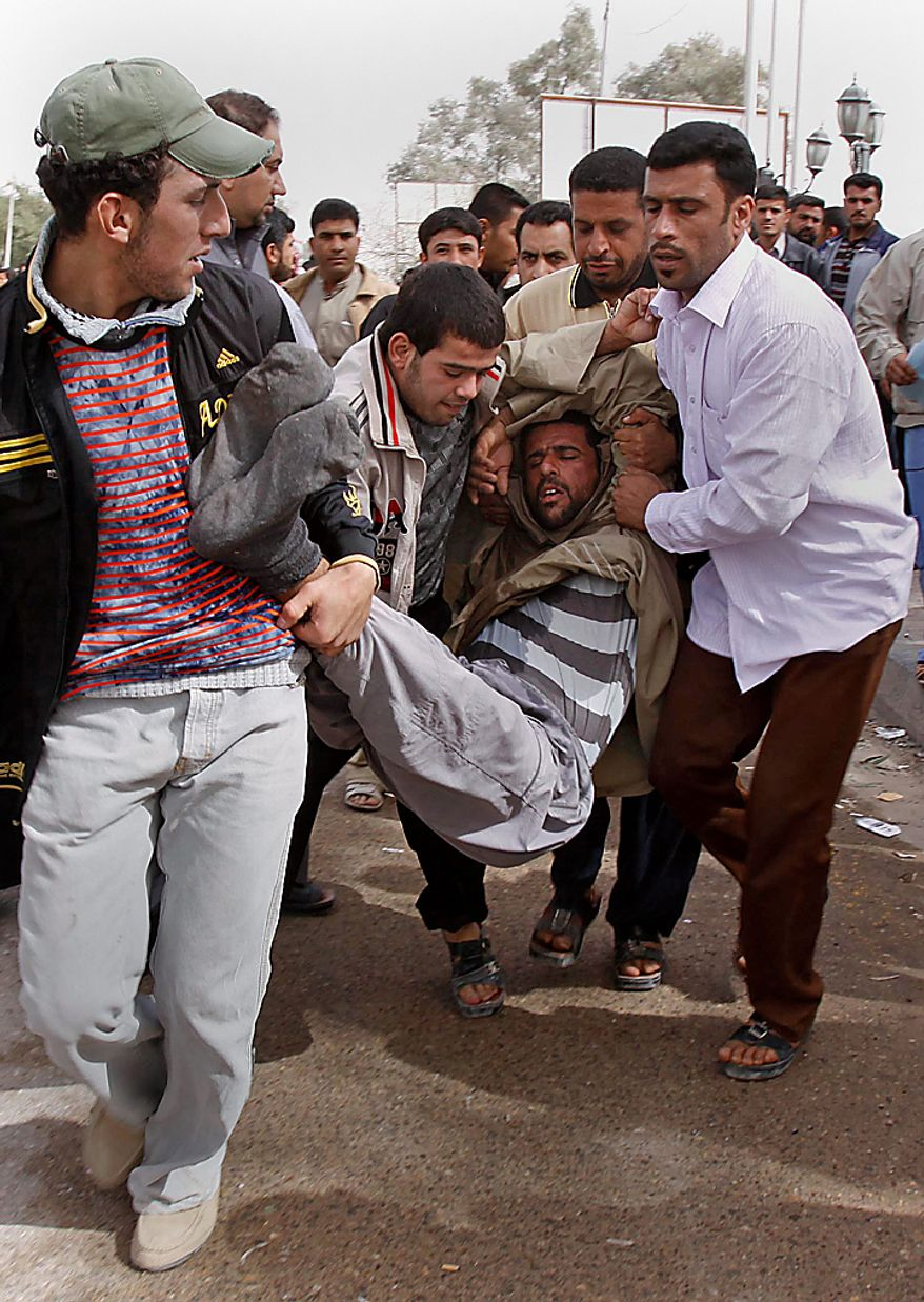 Iraqi anti-government protesters carry a man who collapsed during a demonstration in Basra, Iraq's second-largest city, 340 miles southeast of Baghdad, Iraq, Thursday, Feb. 17, 2011.  Hundreds of Iraqi demonstrators massed in the southern city of Basra to demand the ousting of the local governor, a day after a similar anti-government protest sparked violence that killed a few people. (AP Photo/Nabil al-Jurani)