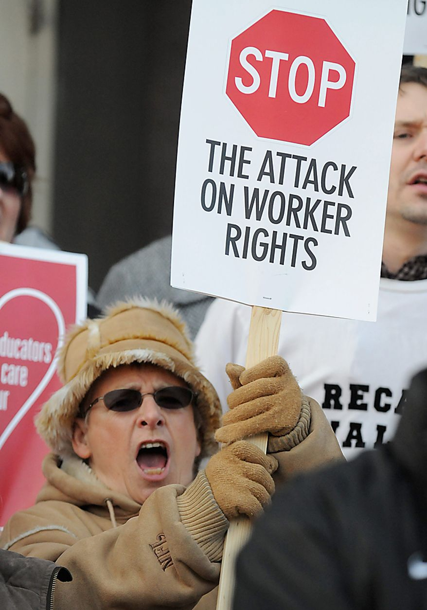 Ginny Fleck attends a rally at the Brown County Courthouse in downtown Green Bay, Wis., on Wednesday, Feb. 16, 2011, to protest Wisconsin Gov. Scott Walker's budget repair bill. (AP Photo/Green Bay Press-Gazette,  H. Marc Larson)