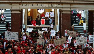 Protesters against Wisconsin Gov. Scott Walker's bill to eliminate collective bargaining rights for many state workers demonstrate in the Rotunda at the state Capitol in Madison, Wis., on Thursday, Feb. 17, 2011. (AP Photo/Andy Manis)