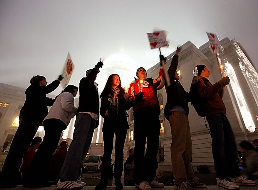 Students from McFarland High School in McFarland, Wis., join opponents of Wisconsin Gov. Scott Walker's budget repair bill during evening demonstrations at the state Capitol in Madison, Wis., on Wednesday, Feb. 16, 2011. (AP Photo/Wisconsin State Journal, John Hart)