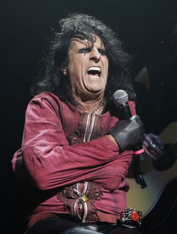 ** FILE ** In this Oct. 31, 2010, file photo, musician Alice Cooper performs his Halloween Night of Fear show at The Roundhouse in north London. Cooper, Jackson Browne, David Crosby and Graham Nash will perform March 10, 2011 in Tucson, Ariz., to benefit a charitable fund established after the