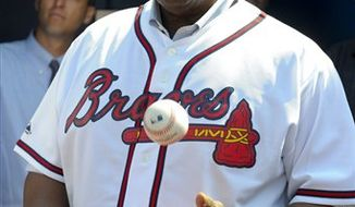 FILE - In this April 5, 2010 file photo, Atlanta Braves executive and Hall of Famer Hank Aaron tosses a baseball prior to the start of the team's opening day baseball game against the Chicago Cubs at Turner Field in Atlanta. Aaron predicts that hitters will bounce back this season following the year of the pitcher. The Hall of Famer also tells the AP he thinks that barring injuries, there's a good chance of a Red Sox-Giants World Series. (AP Photo/Rich Addicks, File)