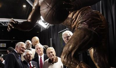 Form Los Angeles Laker Jerry West, NBA commissioner David Stern, Miami Heat president Pat Riley, Lakers owner Jerry Buss and Lakers general manager Mitch Kupchak look at the bronze statue of West during its unveiling ceremony outside Staples Center in Los Angeles, Thursday, Feb. 17, 2011. (AP Photo/Jae C. Hong)