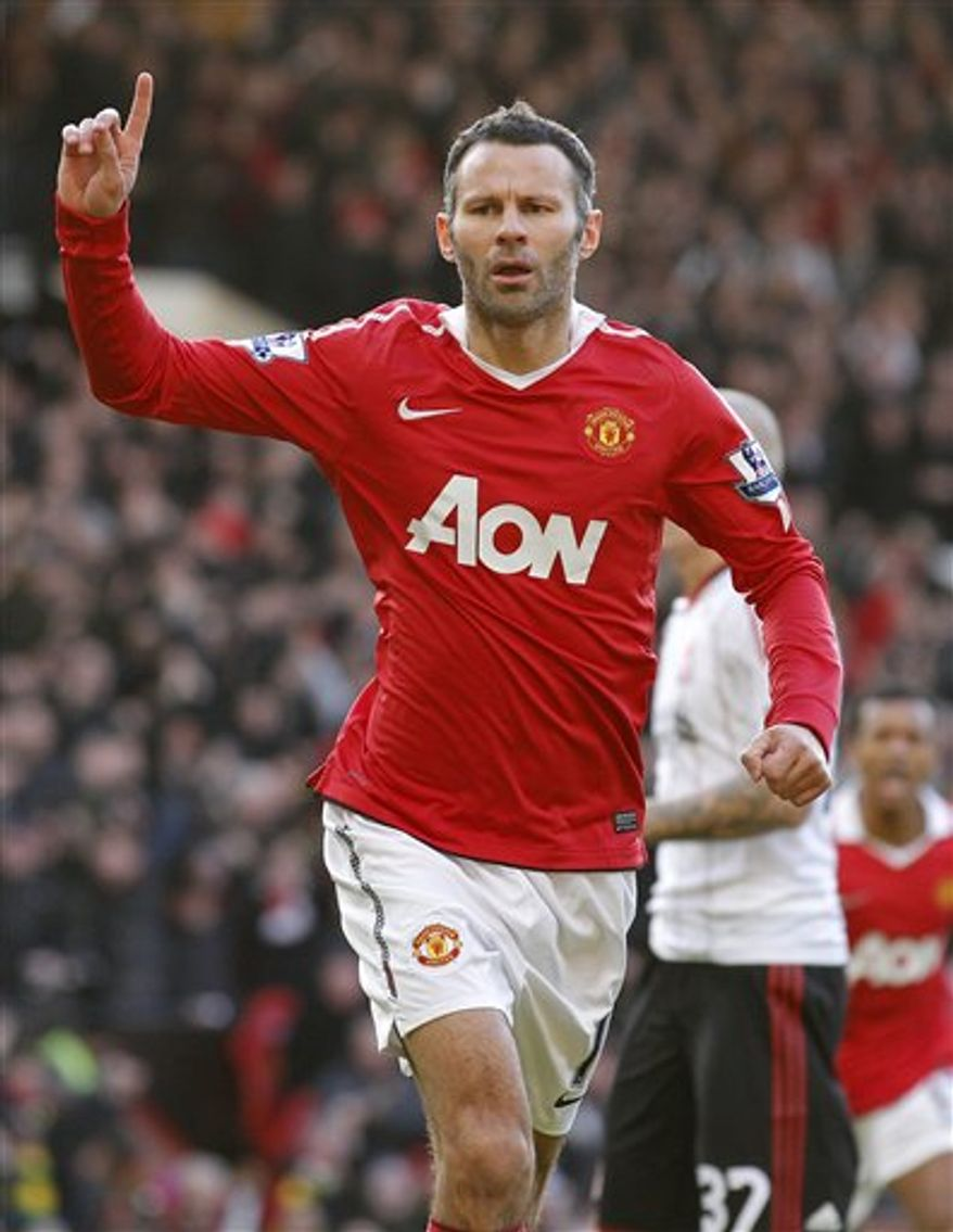 """FILE - In this  Sunday Jan. 9, 2011 file photo Manchester United's Ryan Giggs celebrates after scoring a penalty goal against Liverpool during their English FA Cup soccer match at Old Trafford, Manchester, England. Ryan Giggs signed Friday Feb. 18, 2011 a one-year extension to his contract at Manchester United, tying the veteran winger to the English club until the summer of 2012. The 37-year-old Giggs, who has been one of United's best players this season, says """"it's great to know I'm still contributing to the team's success and I feel I've got a lot to offer on and off the pitch."""" (AP Photo/Jon Super, file) NO INTERNET/MOBILE USAGE WITHOUT FOOTBALL ASSOCIATION PREMIER LEAGUE (FAPL) LICENCE. CALL +44 (0) 20 7864 9121 or EMAIL info@football-dataco.com FOR DETAILS"""